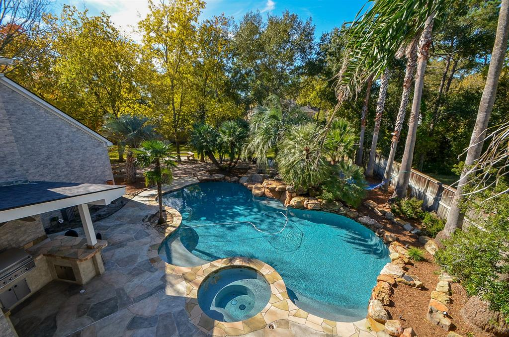 Every day elegance meets practical living at its finest. If you are looking for a large home with all the bells & whistles, on an oversized (1/2 acre) culdesac lot, your search ends now! Located in prestigious Klein ISD, this showstopper boasts 4 large bedrooms, 3 full, 2 half baths; both formals, & 3 generous all-purpose rooms (game, media, flex - but you might use them differently!) The possibilities are endless w/ this much space. Backyard oasis includes pool w/ hot tub & waterfall, covered patio & balcony, outdoor kitchen w/ grill, fridge, tv; pergola, chess board, fire pit, & shed to hide your equipment. Nicely appointed kitchen opens to den, breakfast, & separate wet bar area, allowing for great entertaining space. Multi-speaker sys in-house. Beautiful study down near master. 3 car oversized garage w/ lots of storage + addl covered parking. Auto driveway gate for added security. Roof 2015. Many updates! Walk to elementary. Has NEVER flooded! Be sure to check out the video tour!