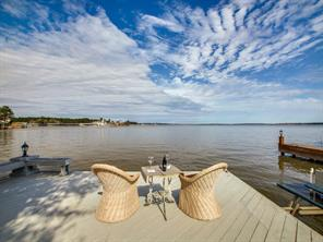Sit, relax and enjoy the view from the private dock of this open-waterfront Bentwater beauty