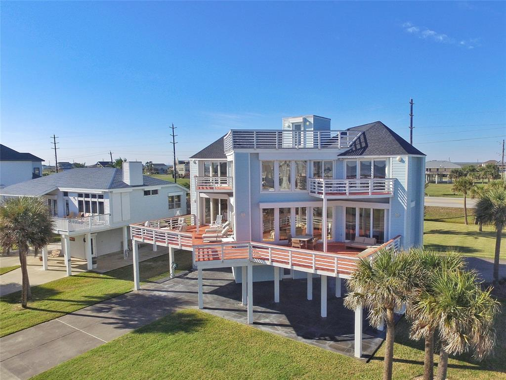 2nd Row Indian Beach treasure situated on over quarter acre corner lot showcases STUNNING beach views from every room & rooftop deck! This home is across street from subdivision beach access. Walls of windows & sliding doors on South side reveal Gulf views & access to multiple decks. Soaring ceiling in living area opens up to a spacious island kitchen with rows of cabinetry & an abundance of granite counters.  Hardwood flooring flows throughout both levels. Your choice of a Master en-suite on each level with deck access and spacious bathrooms. 2nd level landing with double decks would be a great 2nd living area & provides for unbelievable Gulf views! Bunk room features deck access. Most bedrooms showcase built-ins for extra storage capability. Utility room with built-ins & pantry space. Central vacuum. Witness panoramic Gulf views & unbelievable sunrises from the rooftop deck! Driveway on 2 sides of property. Composite decks & handrails. Roof 2016. Fiber cement siding 2017. Furnished.