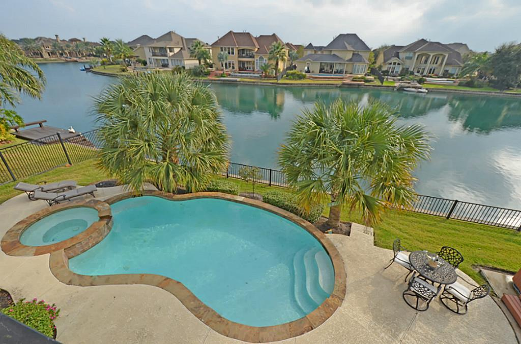 Exquisite family home overlooking the lake! Tropical pool and spa, scraped wood floors, high ceilings, study, formals, family room and gameroom. Wonderful upstairs terrace. This home shows beautifully, and is ready for move in! HOME WAS NOT AFFECTED BY HARVEY.