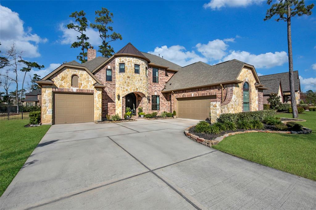 "ABSOLUTE DREAM HOME! THIS ONE HAS IT A-L-L! EXPANSIVE HALF ACRE LOT + 3 GARAGE SPACES + BREATHTAKING INTERIOR! Two Bedrooms & Baths Down + Study + Gameroom + Media Room! Impressive Foyer - Banquet-Sized Dining - Beautiful Millwork + Butler's Pantry! Chef's Dream Kitchen: Stainless Apps + Granite Counters! Five Burner Range with Stone Arch Surround + Pot Filler + Walk-In Pantry! Private Study with Wall of Built-Ins! Supersized Family Room - Surround Sound Wiring + Gas Fireplace with Stone Surround! Dramatic First Floor Master Suite - Picturesque Bay Window + Posh Bath with Oversized Shower & Garden Tub + 2 Large Walk-Ins with Built-Ins! Guest Suite Down + Adjoining Full Bath & Walk-In Closet! Oversized Computer Area + ENORMOUS Gameroom with Direct Access to Veranda - AND Movie Lover's Media Room! 130"" Screen & Projector Stay! LED Down Lighting + Upgraded Light Fixtures + Lutron Wireless Dimming! Covered Back Patio Overlooks HUGE Manicured Yard! Easy Access to Grand Parkway! Conroe ISD!"