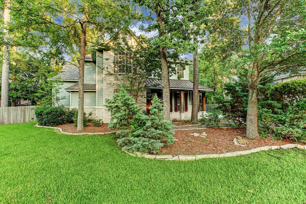 Built with the charm & character of Texas Hill Country, custom home located on huge cul-de-sac lot in one of the most desirable neighborhoods of The Woodlands is a gem & DID NOT FLOOD! The large living area w-gas log fireplace opens to a dine-in kitchen offering abundant white cabinetry, sleek granite countertops, commercial-grade gas range, SS appliances & an island w-extra storage space. Downstairs, an enormous owner's retreat features a spa-like master bath complete w-tub, separate shower, dual sinks & massive walk-in closet. Formal dining & study with built-in's provides a private workplace in light & bright first floor featuring expansive windows. Upstairs 4 spacious guest rooms, jack & jill bath, 2nd full bath & bonus room that can be used for playroom, media room or extra study.  New roof! Oversized true 3-car garage. Energy efficient solar panels. Superb location min to I-45, Grand Pkwy, Hardy Toll, Bush Airport. Exemplary Conroe ISD-Woodlands schools & near college campuses.