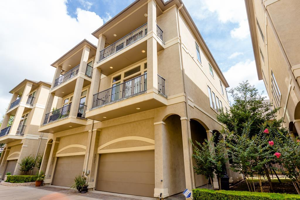 Upscale 3 story townhouse in a quiet, gated community overlooking lush landscaping and bayou/ravine from balconies. Open, spacious living areas on 2nd level w/high ceiling, hardwoods. LR w/fp & surround system, DR open to island kitchen w/granite, stainless appl, breakfast rm, powder bath. Master w/balcony, 2 large closets, gorgeous bath w/granite, travertine plus second br/bath and w/d (stays) on 3rd level. Near the Med center, Braeswood bike trail, the Museum District, Hermann Park, Zoo, University of Houston and everywhere that's appealing.