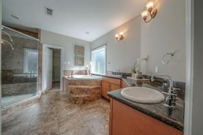 Master bath with over-sized shower, huge walk-in master closet, jetted tub, 2 sinks and cabinet storage.
