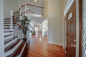 New beautiful stairway leads to 3 bedrooms and a game room over the garage.