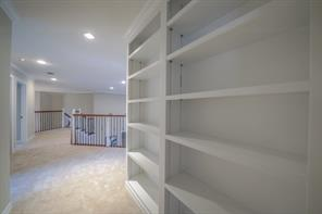 Built-in shelves in the hallway upstairs are great for book, game and collection viewing.