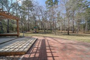 Back yard has a decked area and patio for enjoying the outdoors. Playset is included with the sale of the home. There are main sprinkler lines, valve boxes and wiring installed for the entire property - just add sprinkler heads and zone valves where needed.