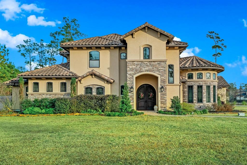 All I want for Christmas, is this HOUSE!! Imagine coming home to this sophisticated and luxurious retreat perfectly situated on over an acre lot in Benders Landing Estates. Under one area is the living room, wine grotto, kitchen and formal dining which is a great flow for living and entertaining. A must see is the beautiful travertine flooring, wood beams, soaring ceilings, chefs kitchen with a large island, stone accents, oversized pantry, stone fireplace and wet bar. With the master and two bedrooms down this is a great fit for all kinds of families. Master bathroom has a walk in shower and huge soaker tub. This master closet has it all. With two elegant staircases that lead you upstairs to a gameroom, media room with projector TV, and bedroom with a full bath. This backyard is an oasis with a covered sitting area, pool, spa, and outdoor kitchen.  Not to miss is the large laundry room and spacious 3 car garage. Located off I-99, Hardy Toll Rd and I-45. Zoned to the new High School