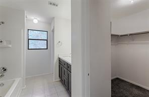 Master bath with large walk-in closet, tub/shower combo, new shaker style cabinets and counter tops.  WOW!