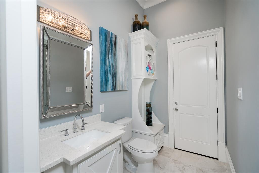 dc76886df6 Downstairs half bathroom dressing room offers marble countertops