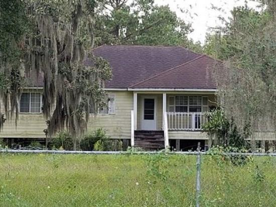 Wanting that private space of your own...This may be it...Located on 4.8 Acres, this well rounded home has 3 bedroom and 2 full bath with open living space...Large covered front porch, fully fenced and more...Great for entertaining or a place to enjoy the outdoors...Drive by only!!