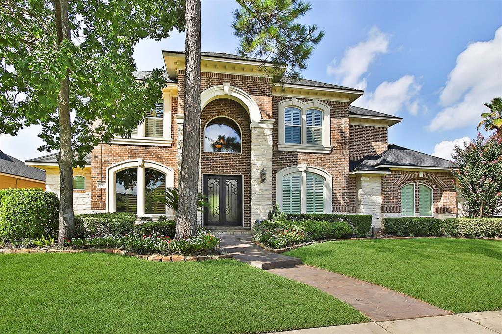 RING IN THE NEW YEAR WITH A MAGNIFICENT ESTATE HOME LOCATED IN A GATED COMMUNITY! From the inviting grand iron door entry and open floor plan to more intimate living spaces, this home is perfect for entertaining and quiet living.  This stunning custom home features a second bedroom down, formal dining room, sitting room, custom millwork throughout. The gourmet kitchen boasts Jenn-Air appliances, rich stone backsplash, two-toned island and breakfast bar. With high ceilings and frameless glass windows, the view to backyard is a must see. Deluxe master suite and spa like bath with over-sized walk-in closet. Gracious secondary bedrooms, game room, media room upstairs.  Recently added, a relaxing lagoon style swimming pool and mosquito misting system. There is also ample green space for kids and furry friends to run around. Three-car garage with epoxy floor! Roof replaced in 2017. Close to ExxonMobil, 249, 99 and I-45.