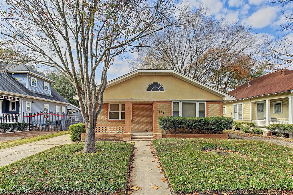 Charming Bungalow in prime Heights location! Sizable living space, kitchen and bedrooms.  Hardwood and tile flooring, built ins, back patio space, detached two car garage and a great front yard! Refrigerator, stackable washer/dryer are included.