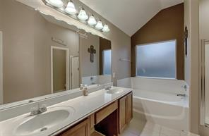 Terrific sized bathroom area with lots of lighting and high ceilings.