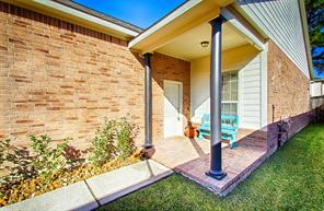 Finished covered porch has a designer look with the matching bricked flooring.