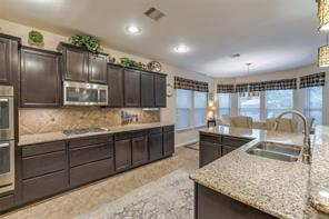 With double ovens, a 4 burner gas stove, and granite countertops, this kitchen is a dream.