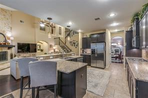 Open to the living room and breakfast area, this kitchen is perfect for entertaining!