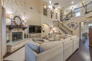 Open living room with 2 story ceilings and a statement fireplace.