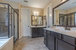 Master bath has double vanities, soaking tub, walk-in oversized shower, and walk-in closet.