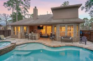 Backyard oasis with inground pool that is fully heated and offers a sundeck for the ultimate pool experience!