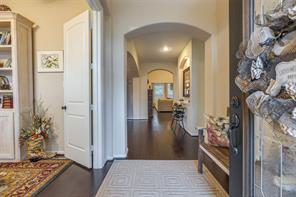 Entry to the home featuring stunning wood floors, arched doorways throughout, and 8 foot doors (on the bottom level).