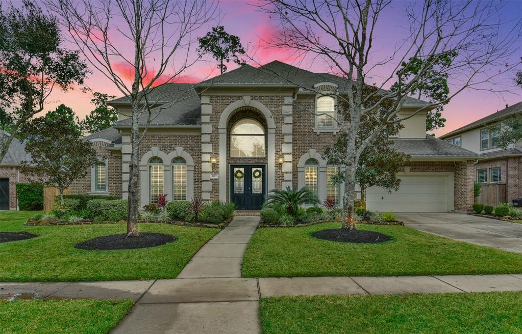 A stunning home by Partners in Building, located in the golf course community of Fall Creek. This home has many luxurious touches including a dramatic entry, climate-controlled wine room, hardwoods, tile throughout, double crown molding, high ceilings, shutters, and built-ins. Commercial-grade $10,000 security system. Entertain in style in the gourmet kitchen featuring SS Jenn-Air & Kitchenaid appliances, double ovens, a butler's pantry, ample granite counter space, and huge island. Retreat to the large, private master suite and spacious master bath and closet. A second bedroom is downstairs, perfect for a nursery, guest room or 2nd home office. Upstairs you will find a game room, media room, and three spacious bedrooms. A three-car tandem garage features built-in cabinetry and huge storage closet. The backyard oasis has lush landscaping, a covered seating area, outdoor kitchen, fireplace, and pool & spa. This home has no immediate neighbors behind for privacy! High & Dry in Harvey.