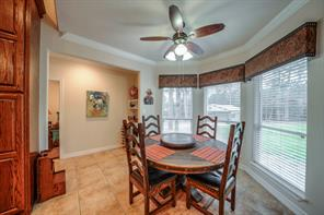 There is great space in the breakfast room, could go larger on the table size if needed. Sellers are currently using the desk area as a wine bar, but easily used as desk area with drawer reinserted.