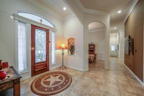 Tiled spacious entry and gorgeous door greet you upon entering.