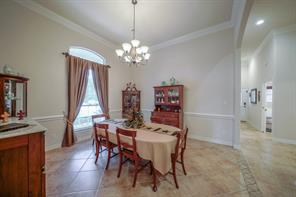 Formal dining is open to kitchen and has plenty of space for buffet or china cabinet to accompany the dining set.