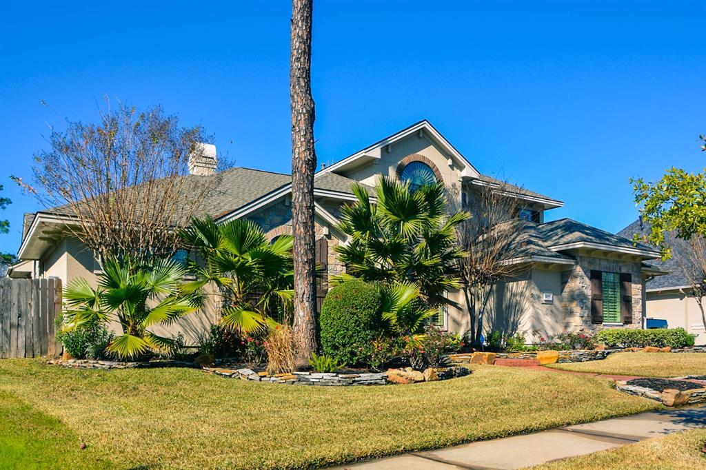"Lush landscaped front with stone elevation & stone edge flower bed, stucco exterior. Huge lot with outdoor kitchen & fireplace & extensive bricked patio. Wood floor thru-out the house, even 2nd floor except ceramic tile in all wet areas. Large open Island kitchen with granite counter, s.s. double oven, cooktop, dishwasher & tile backsplash & large walk-in pantry & large family room. Lot of natural light. 12"" ceiling thru-out 1st floor. Separate entry for guest quarter with adjoining bath & small kitchen, idea for ""sandwich generation"" with elderly in the family. Large master down with 12x11 walk-in, granite counter, air-bubble Jacuzzi, double shower, his & her vanities. Plantation shutters replaced. Spacious gameroom & home theater Roof 2 year, A/C system 1, 3, & 5 yrs old."