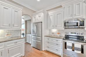 Kitchen offers granite countertops and subway tile backsplash.