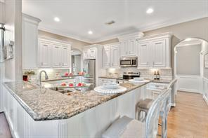 Wrap around breakfast bar provides additional seating in this open kitchen.