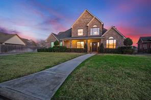 Grand curb appeal with landscaped flower beds and inviting sidewalk up to the front door.