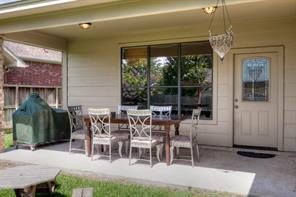 Rear covered porch great for summer BBQ dinners and entertaining.