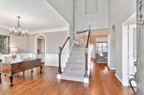 Two story foyer with stairs leading up to the secondary bedrooms and bath.