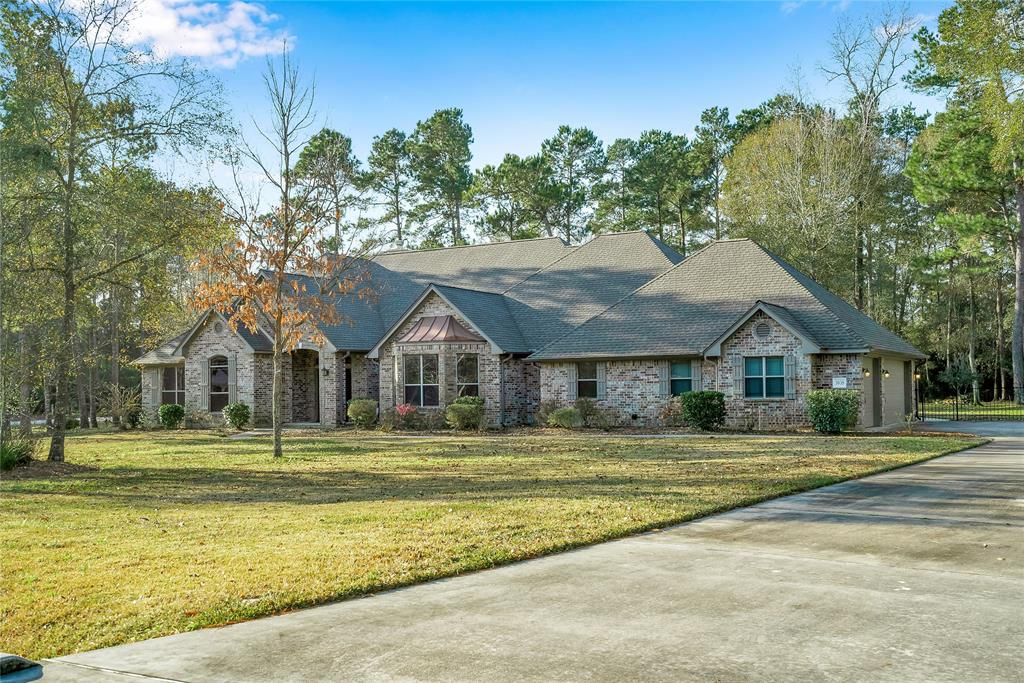 Set a new standard of living in this entertainer's dream home! Spectacular one story, 4 bedroom, 3½ bath home has all the conveniences of city living, yet feels like you are in the country. This 1 acre corner lot, in the highly sought after Benders Landing neighborhood, is wooded with wildlife abound. Easy access to the Grand Parkway and 45 makes commuting to Bush International, Exxon, SWN, and The Woodlands with all its shopping and dining experiences a breeze. The eat in kitchen overlooks the expansive living area and can accommodate large groups of family, friends and sports enthusiasts. Other features include, elegant formal cathedral ceiling dining room, fireplace, coffered ceiling study with custom shelving, closets galore, custom built in shelving, Nuvia water filtration system, RO under kitchen sink, expansive master closet, back room has en-suite bath and exterior door, 3 car garage with epoxy flooring, back porch and additional covered area perfect for outdoor entertaining.