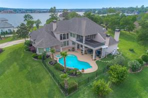 Welcome to 326 Promenade W! An elegant home with breathtaking views of Lake Conroe.