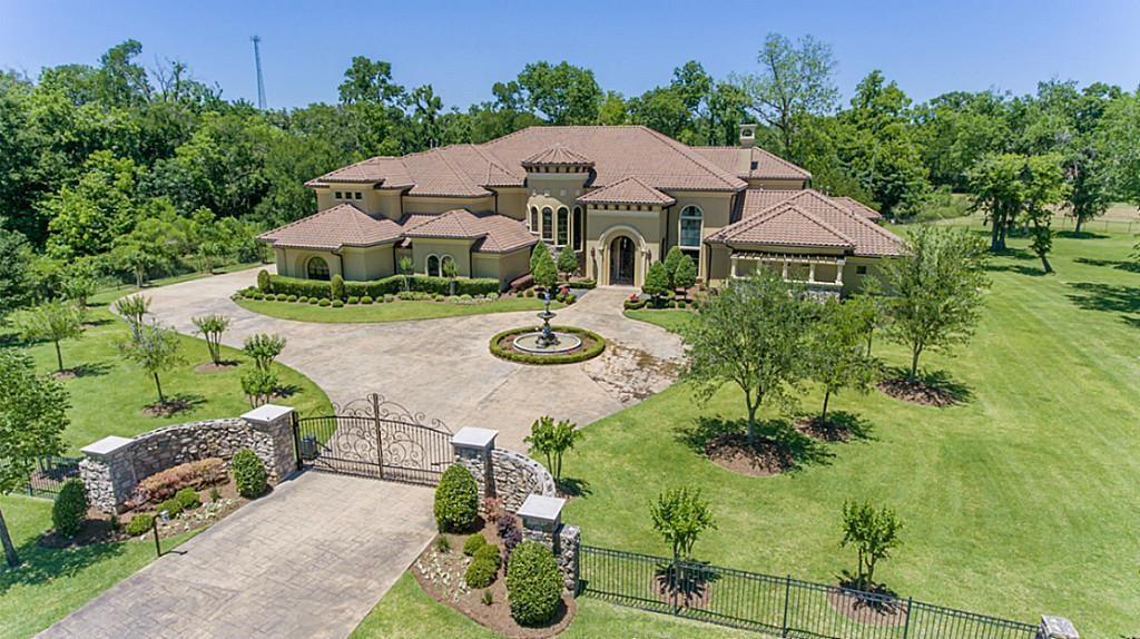 """One of Fort Bend's finest Estate properties (Please see """"Property Information"""" in attachments to this listing for specific property information/details). Serene, gated, pristine Tuscan Villa on 1.94 acres (adjoining 1.62 acre lot available). Everything is in place/ready for new owners. Luxurious space throughout with absolute finest available finishes and materials. Two Master Suites, caterer's kitchen off main kitchen and two utility rooms.  Indoor and outdoor entertaining for large groups or intimate family gatherings. Huge pool, Casita with living space, kitchen and bedroom. Five car oversized garage with generous outdoor parking and a circle drive. Very private, quiet and secluded, no rear neighbors. Home is as if it has not been lived in. Majority of Furnishings negotiable. Not in any floodplain, NEVER FLOODED. 1.8641 real estate tax rate, NO MUD and LCISD K-12 recently built campuses all within minutes. Galleria is 30-35 minutes away. Room measurements estimated, please confirm."""