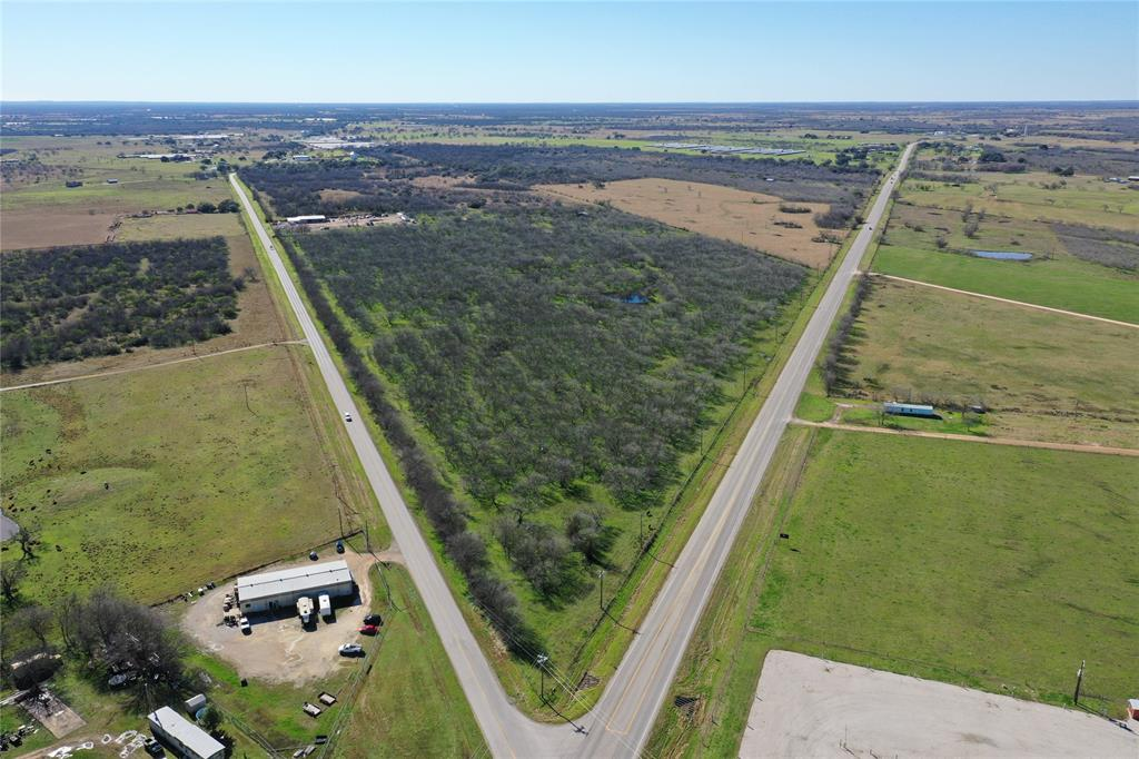 Gonzales County livestock and hunting land with easy access off Hwy 97 W or FM 108, close to town.  Mixed native grass areas with hardwoods coupled with brushy areas suitable for wildlife. Co-op water and electricity available, 2 stock tanks, barn and perimeter fencing. Ag exemption in place.  Currently leased for cattle and hunting.