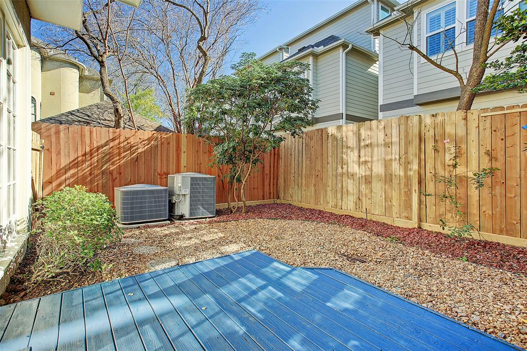 Spacious, fenced back yard with a deck