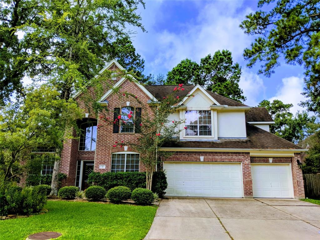 Beautiful and immaculately kept home in desirable Woodlands community. Soaring ceilings, walls of windows, granite kitchen w/island and upgraded vent a hood, cherry cabinets. Formal dining room is separated from the kitchen by butlers pantry. Den is open to the kitchen with cozy fireplace. Texas sized master/bathroom with upgraded cabinets. Oversized game room with computer nook. Larger lot w/wooded backyard/deck. Park in walking distance.