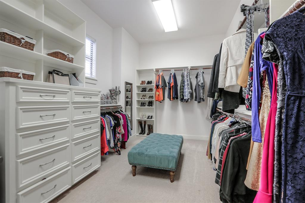 This enormous master closet will satisfy some storage needs and make some people happy!