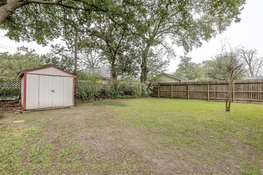 The backyard is really, really big. There is plenty of room to add on to the back of the home. Since, this home is not restricted by the Historic district, you may have a little more options for renovation.