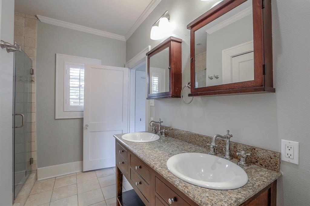 The master bathroom has tons of modern amenities, which as a double sink vanity and a walk-in shower.