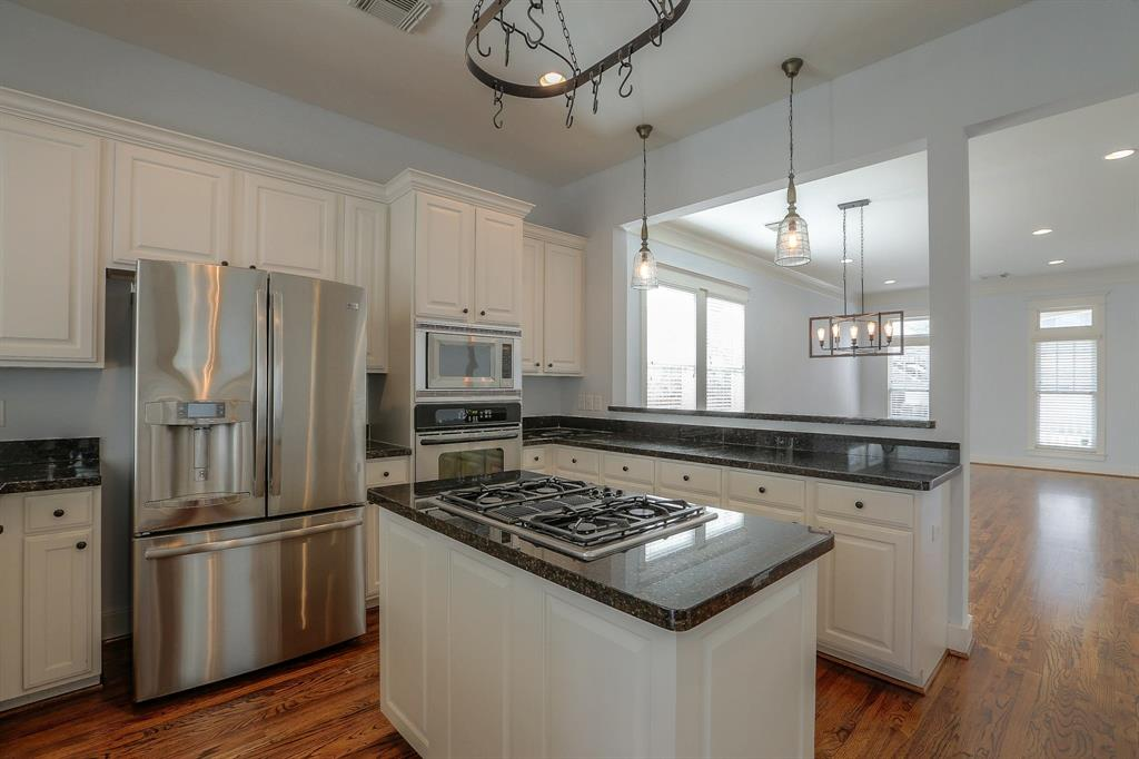 Spacious Kitchen features granite countertops and stainless steel appliances.