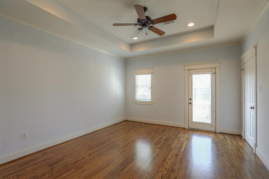 Master Suite features recessed ceiling, wood floors and lots of light.