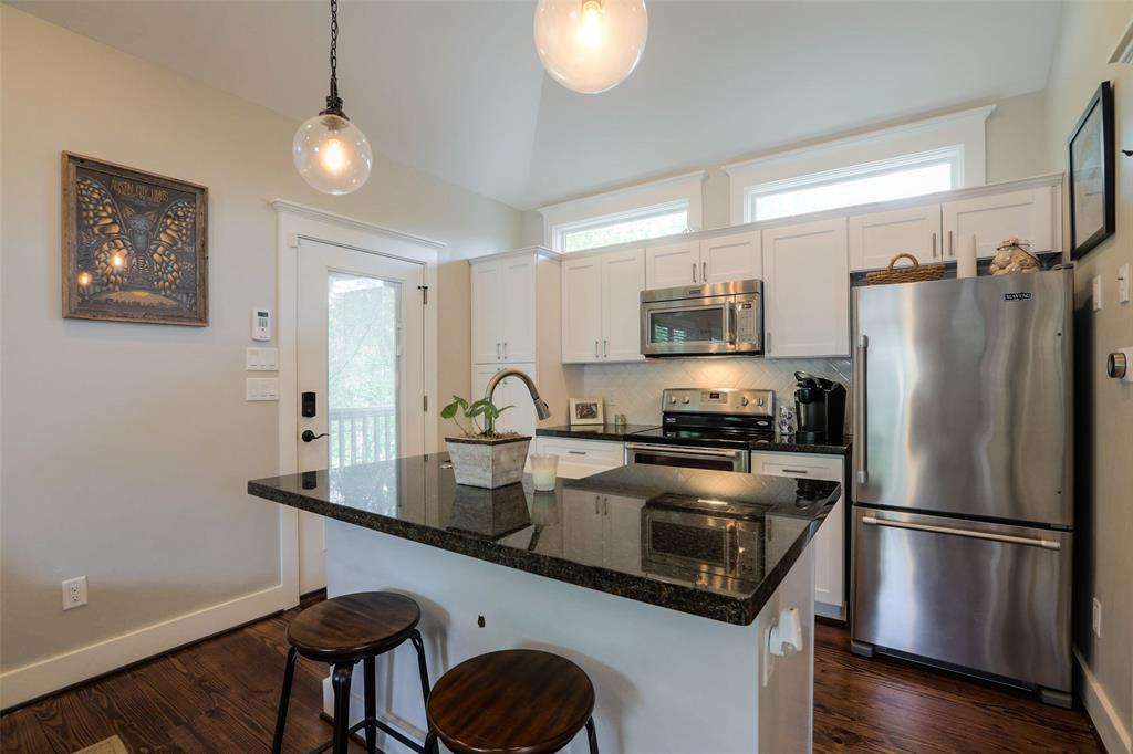 Garage Apartment Kitchen also features granite countertops and stainless steel appliances. Light and bright!