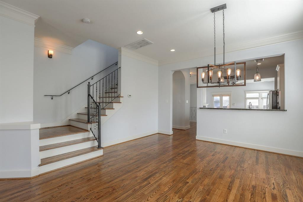 Open floor plan with lots of natural light! Refinished wood floors shine like new. Large Dining area.