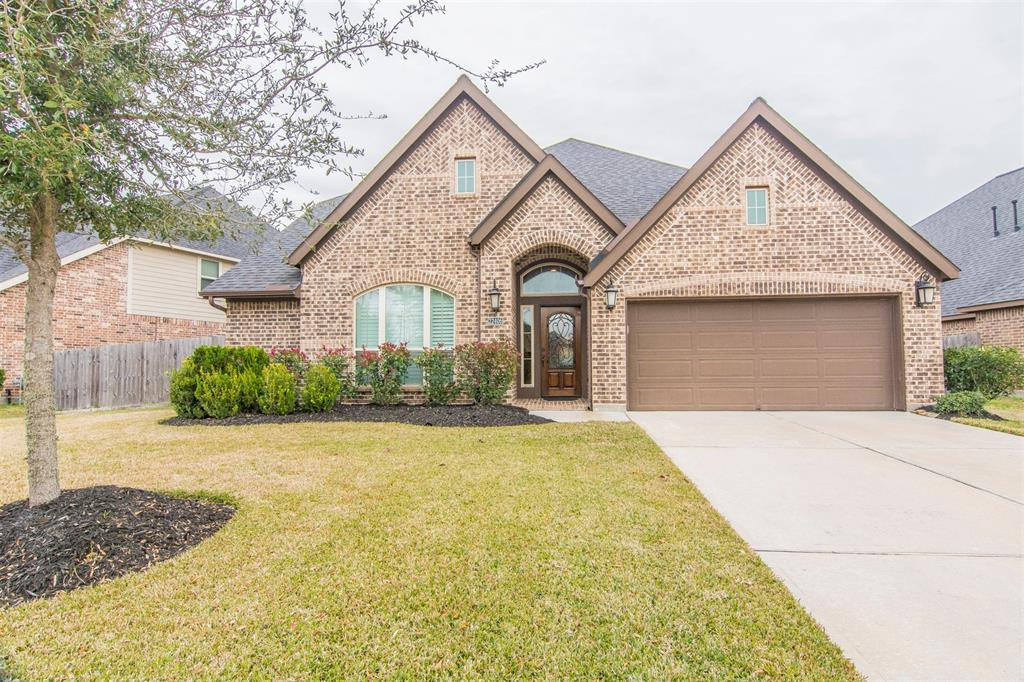 This gorgeous home is upgraded in every area. It has 3/4 large bedrooms on the first floor. The master bedroom has 12' ceilings, crown molding and plantation shutters. The master bathroom includes a 6' jetted tub, separate shower and duel sinks that opens to a large walk-in closet. The family room has a stone fireplace with gas logs and opens to the kitchen which includes high end stainless appliances, an island, granite countertops and breakfast area. The separate formal dining area is great for family gatherings. The office/living room or 4th bedroom is a very flexible space. The second floor features a theater room with surround sound, spacious game room and a half bath. This fabulous 3 or 4 bedroom home has 3 1/2 bathrooms all with granite countertops. There's custom plantation shutters, crown molding throughout and plenty of storage space. The backyard has a large covered patio area that's great for entertaining.
