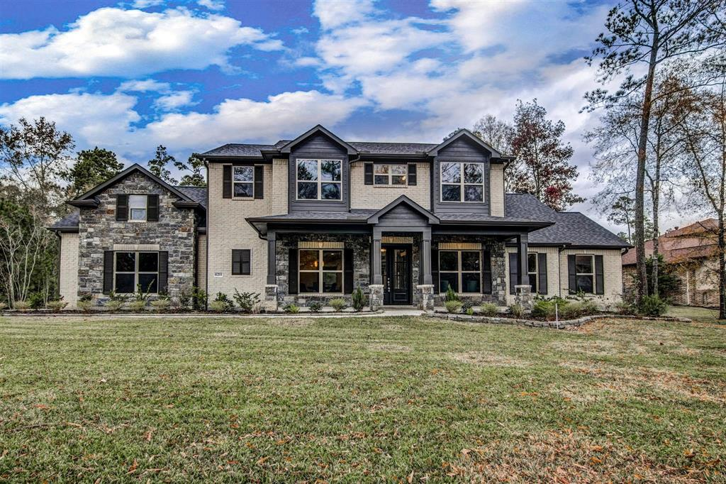 Craftsman style exterior with modern interior decor sits on a 1 acre wooded lot.  This 4-5 Bedroom home has 3.5 Baths and a Game Room.  The Master bedroom, Study, and 1.5 Baths is downstairs, while 3-4 bedrooms, Game Room, and 2 full baths are upstairs.  Beautiful Kitchen with Kent Moore cabinetry, large pantry, & large island open concept to the Family Room with beamed ceilings and rustic stone fireplace w/wood beam mantle.  A sliding glass door leads to a covered patio with outdoor kitchen and your spectacular backyard view of a fully sodded backyard with irrigation system, trees, and no backyard neighbors.  Unique features of this home includes a Hobby/Storage Room upstairs (could be a 5th bedroom), a dog shower located in the Utility room, Gourmet Kitchen with a pot filler, double oven, and a Butler's Pantry with glass front upper cabinets.  Schedule your showing today.  This Energy Star Rated home in Benders Landing Estates has access to private clubhouse, pool, and tennis courts.